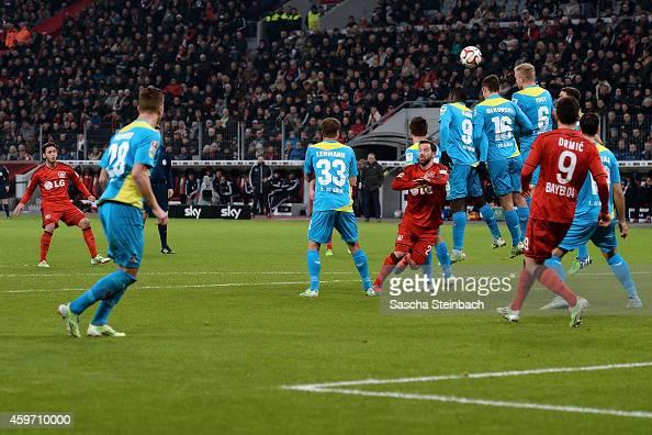 Hakan Calhanoglu of Leverkusen scores his team's second goal from a freekick during the Bundesliga match between Bayer 04 Leverkusen and 1 FC Koeln...