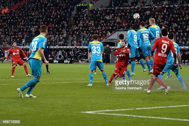 Hakan Calhanoglu of Leverkusen scores his team's second goal from a freekick during the Bundesliga match between Bayer 04 Leverkusen and 1 FC Koeln...