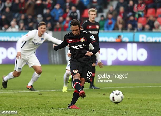 Hakan Calhanoglu of Leverkusen scores the penalty goal during the Bundesliga match between Bayer 04 Leverkusen and Hertha BSC at BayArena on January...