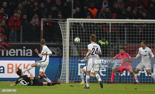 Hakan Calhanoglu of Leverkusen scores the third goal during the Bundesliga match between Bayer 04 Leverkusen and Hertha BSC at BayArena on January 22...
