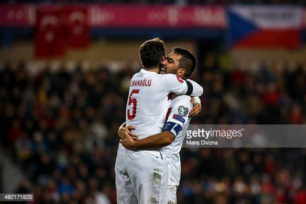 Hakan Calhanoglu of Turkey celebrates his goal with his teammate Arda Turan during the UEFA EURO 2016 Group A Qualifier match between Czech Republic...