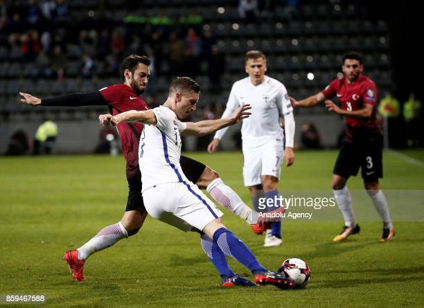 Hakan Calhanoglu of Turkey in action against Juha Pirinen of Finland during the 2018 FIFA World Cup European Qualification Group I match between...