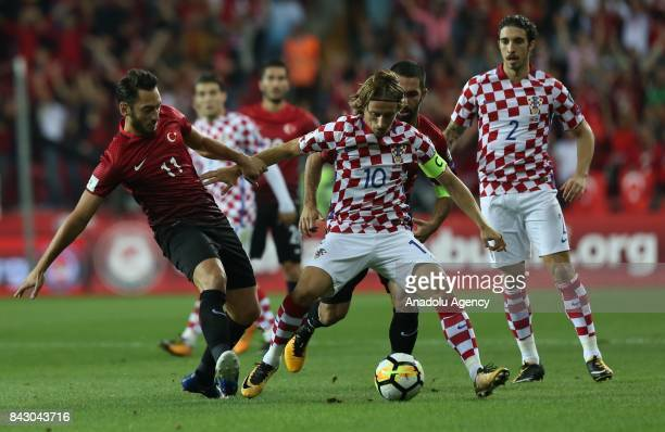 Hakan Calhanoglu of Turkey in action against Luca Modric of Belgium during the 2018 FIFA World Cup qualification Group I match between Turkey and...