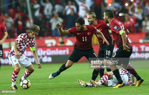 Hakan Calhanoglu of Turkey in action against Luka Modric of Croatia during the 2018 FIFA World Cup qualification match between Turkey and Croatia at...