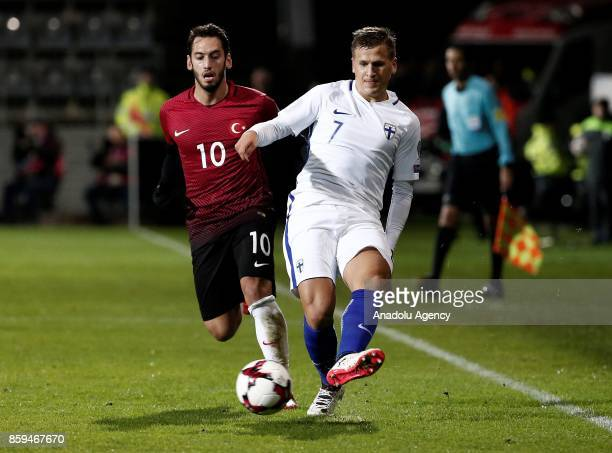 Hakan Calhanoglu of Turkey in action against Robin Lod of Finland during the 2018 FIFA World Cup European Qualification Group I match between Finland...