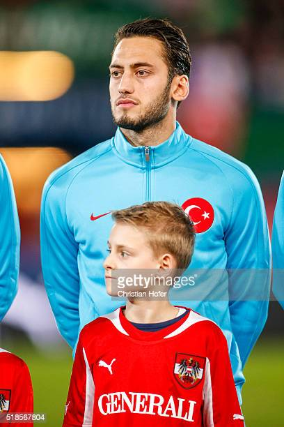 Hakan Calhanoglu of Turkey lines up during the national anthem prior to the international friendly match between Austria and Turkey at...