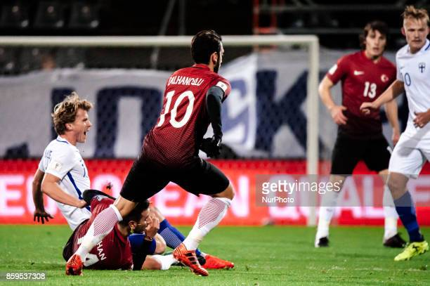 Hakan Calhanoglu of Turkey vie for the ball during the FIFA World Cup 2018 qualifying football match between Finland and Turkey in Turku Southern...
