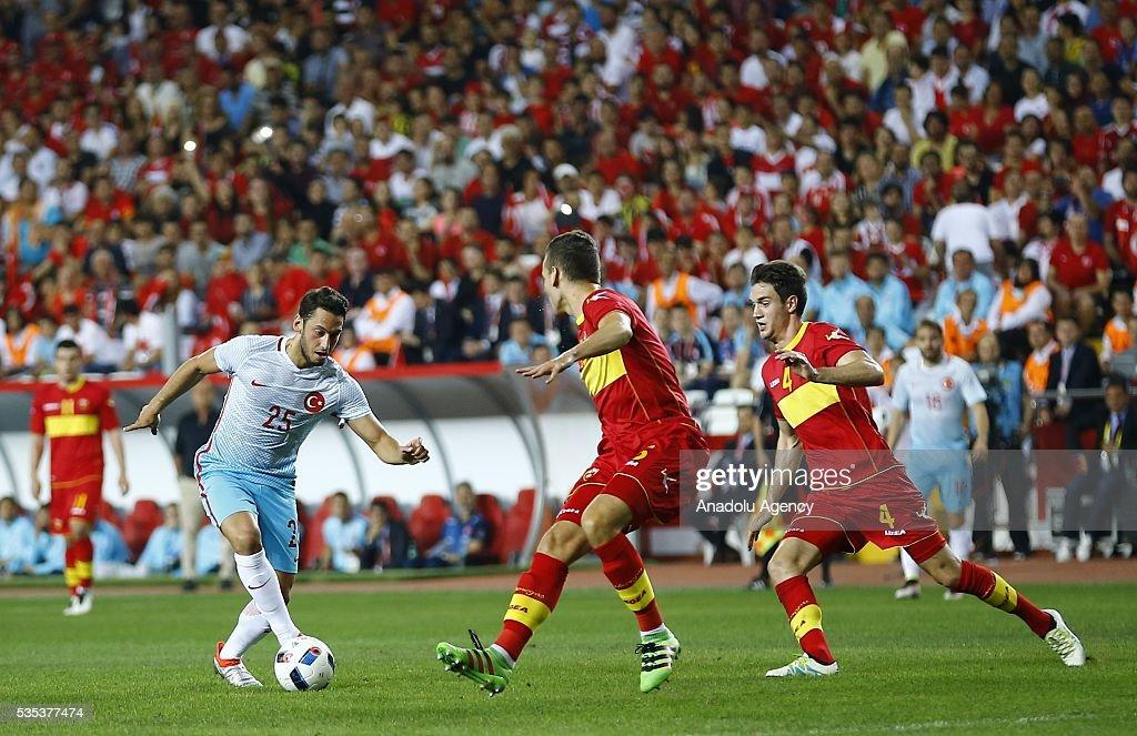 Hakan Calhanoglu (L) of Turkey vies for the ball during the friendly football match between Turkey and Montenegro at Antalya Ataturk Stadium in Antalya, Turkey on May 29, 2016.