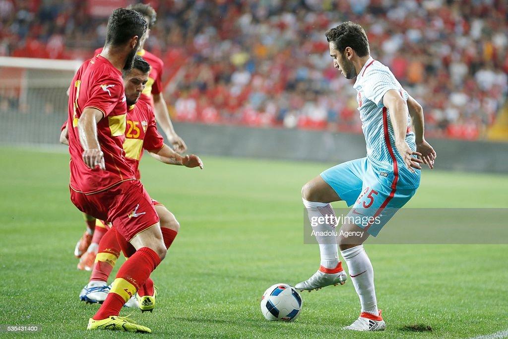 Hakan Calhanoglu (R) of Turkey vies for the ball during the friendly football match between Turkey and Montenegro at Antalya Ataturk Stadium in Antalya, Turkey on May 29, 2016.