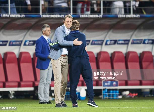 Hakan Ericson head coach of Sweden is hugged by Simon Tibbling of Sweden after the UEFA European Under21 match between Slovakia and Sweden at Arena...