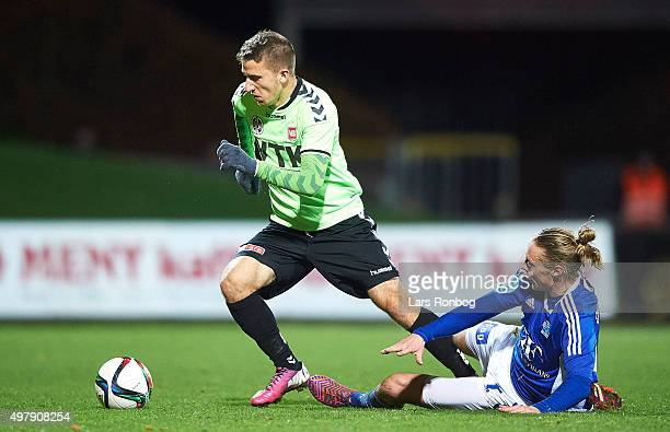 Hakan Redzep of Vejle Boldklub and Jesper Christjansen of Lyngby Boldklub compete for the ball during the Danish 1th Division Bet25 Liga match...