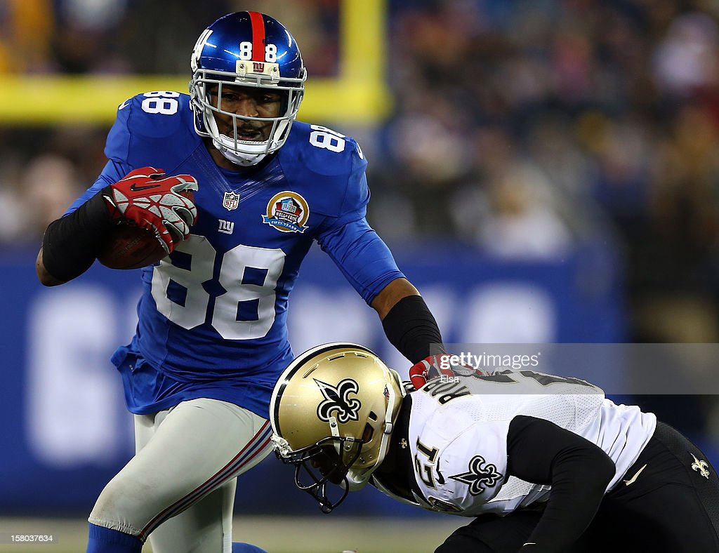 Hakeem Nicks #88 of the New York Giants carries the ball as Patrick Robinson #21 of the New Orleans Saints defends on December 9, 2012 at MetLife Stadium in East Rutherford, New Jersey.