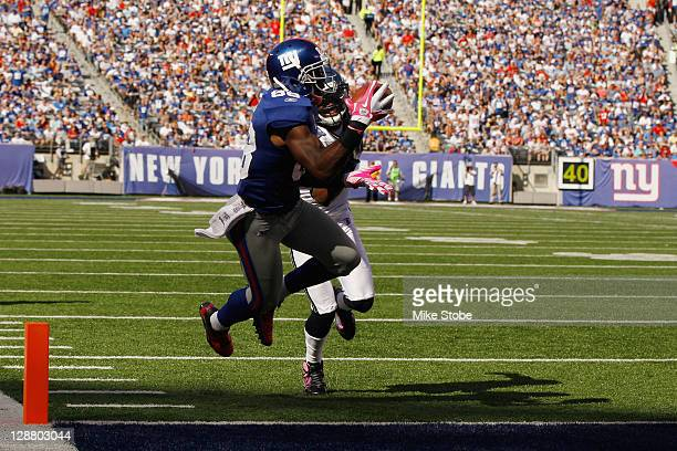 Hakeem Nicks of the New York Giants catches a touchdown pass in front of Walter Thurmond of the Seattle Seahawks at MetLife Stadium on October 9 2011...