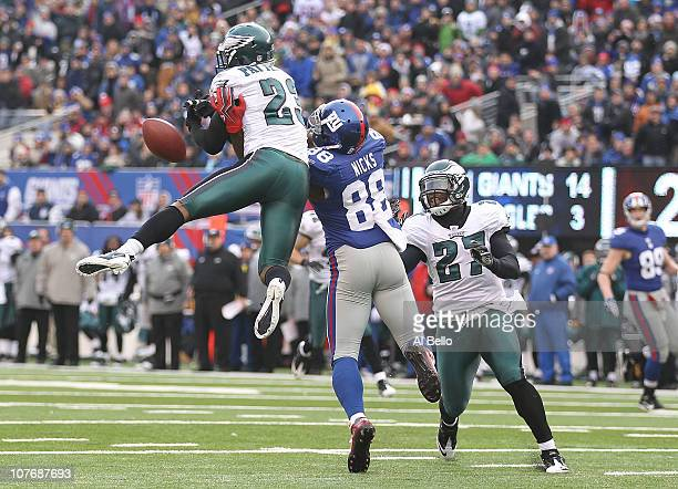 Hakeem Nicks of the New York Giants has a pass broken up by Dimitri Patterson of the Philadelphia Eagles during their game on December 19 2010 at The...