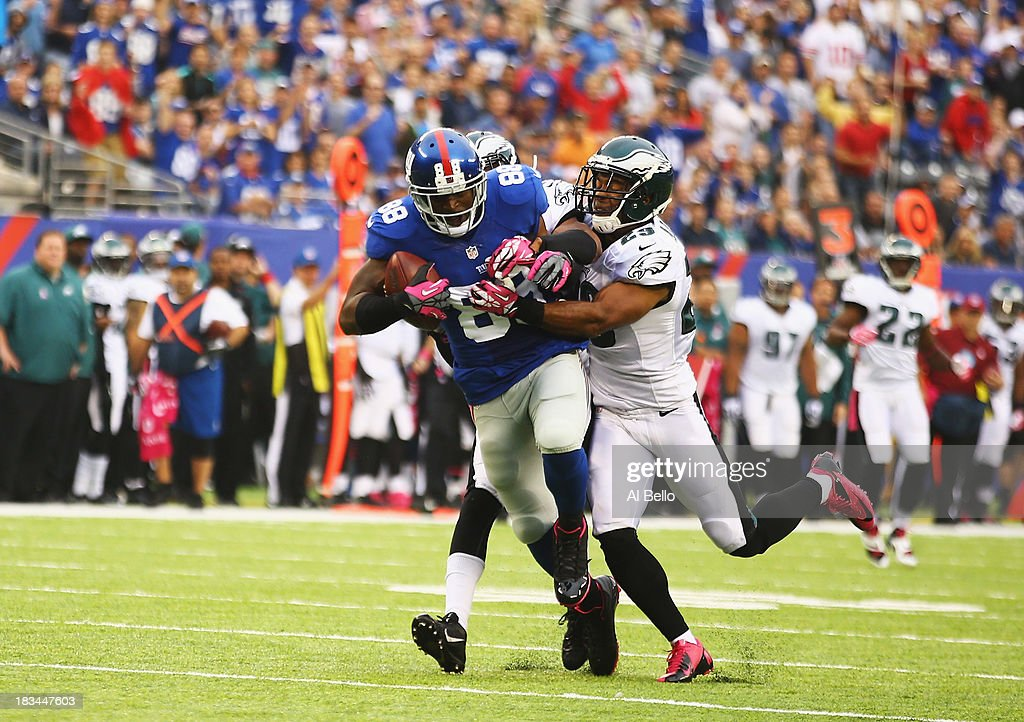 Hakeem Nicks #88 of the New York Giants runs after a catch as Nate Allen #29 of the Philadelphia Eagles defends in the first quarter during their game at MetLife Stadium on October 6, 2013 in East Rutherford, New Jersey.
