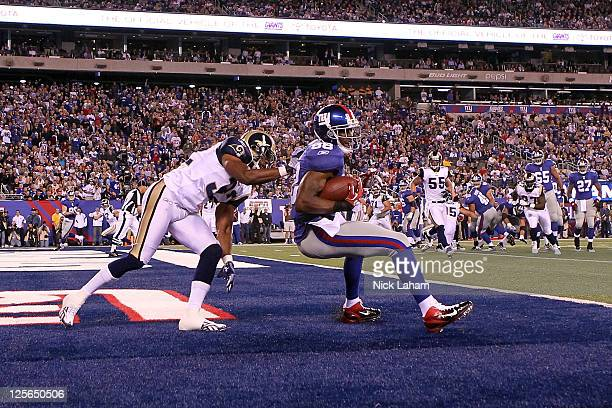 Hakeem Nicks of the New York Giants scores a 3yard touchdown reception in the first quarter against Bradley Fletcher of the St Louis Rams at MetLife...