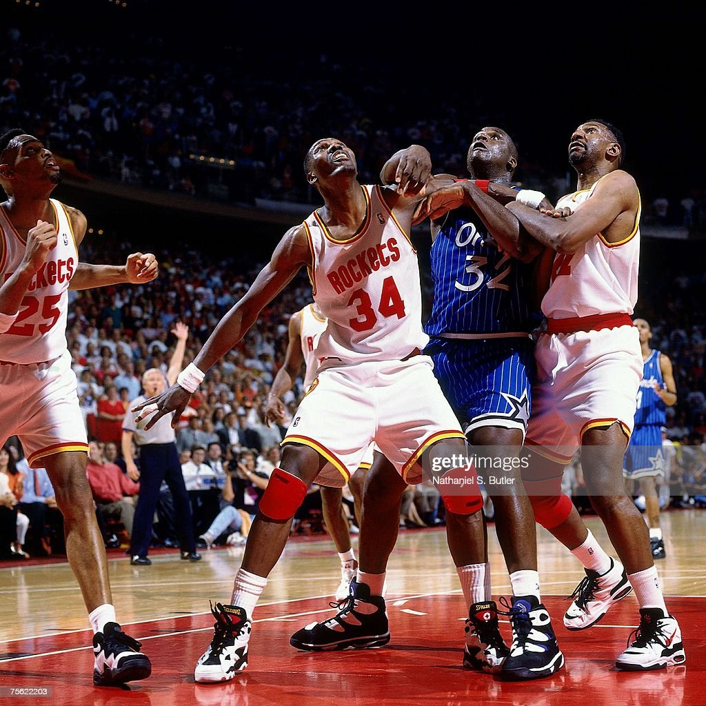 Hakeem Olajuwon #34 of the Houston Rockets battles for position against Shaquille O'Neal #32 of the Orlando Magic in Game Four of the 1995 NBA Finals played June 14, 1995 at the Summit in Houston, Texas. The Rockets won 113-101.
