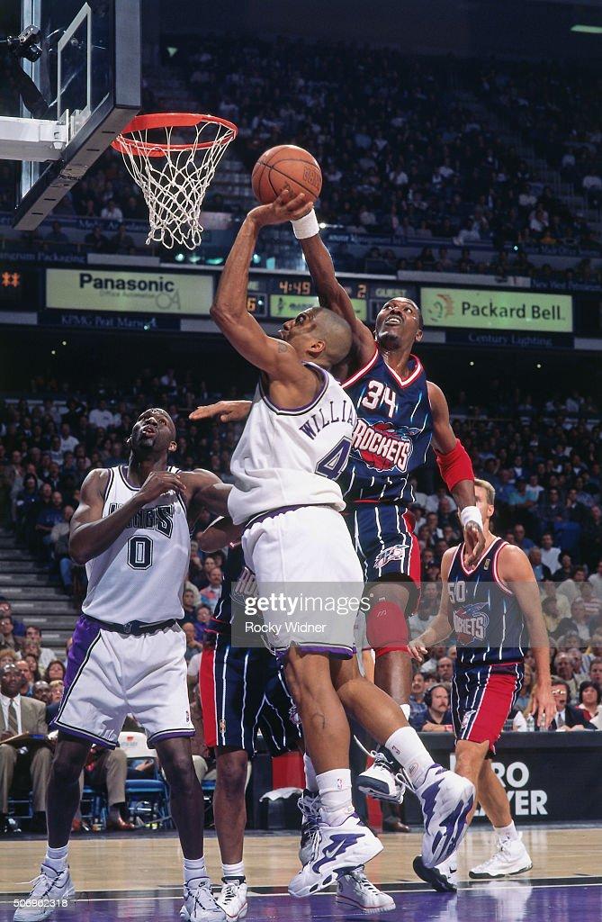 Hakeem Olajuwon of the Houston Rockets blocks a shot attempt against the Sacramento Kings circa 1997 at Arco Arena in Sacramento California NOTE TO...