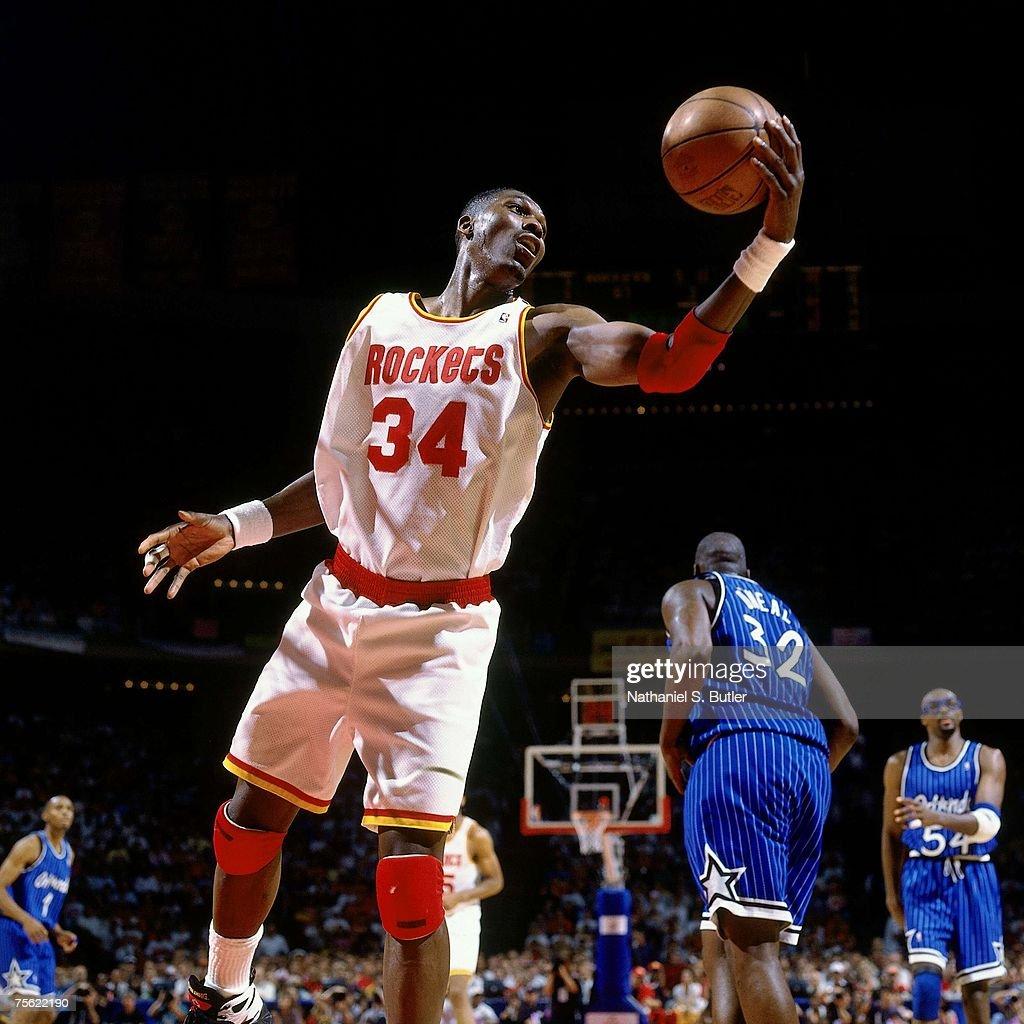 Ho houston rockets nba championship - Hakeem Olajuwon 34 Of The Houston Rockets Grabs A Rebound Against Shaquille O Neal