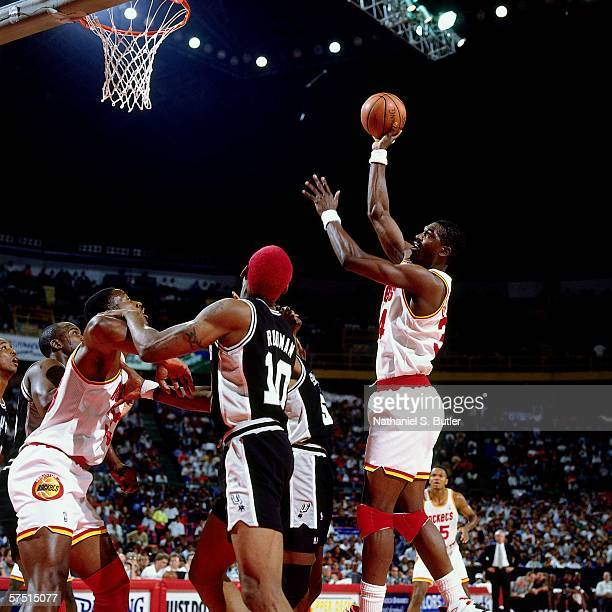 Hakeem Olajuwon of the Houston Rockets shoots against David Robinson and Dennis Rodman of the San Antonio Spurs during the 1994 NBA Challenge at the...