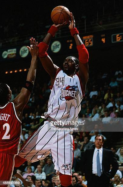 Hakeem Olajuwon of the Houston Rockets shoots over Lorenzen Wright of the Atlanta Hawks during the game on April 7 2001 at Compaq Center in Houston...