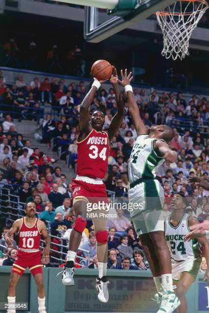 Hakeem Olajuwon of the Houston Rockets takes a jumpshot against the Milwaukee Bucks circa 1990 at the Bradley Center in Milwaukee Wisconsin NOTE TO...