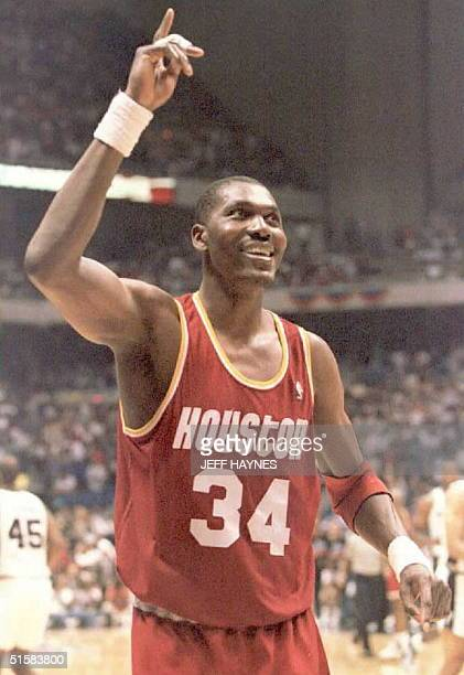 Hakeem Olajuwon of the Houston Rockets walks off the court after leading the Rockets to a 10696 victroy against the San Antonio Spurs 24 May during...