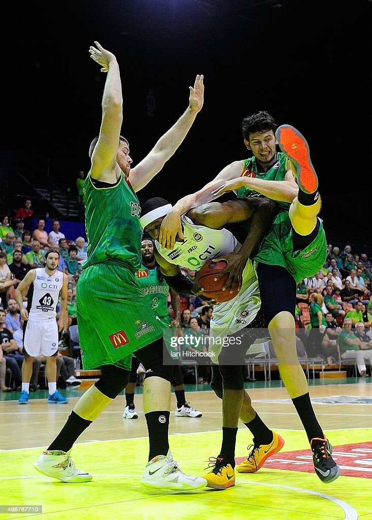 Hakim Warrick of Melbourne United contests the ball with Brian Conklin and Clint Steindl of the Crocodiles during the round eight NBL match between...