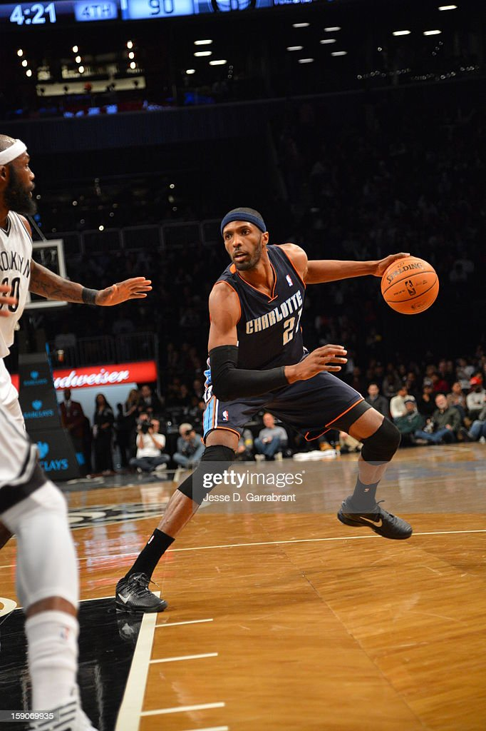Hakim Warrick of the Charlotte Bobcats dribbles the ball against the Brooklyn Nets during the game at the Barclays Center on December 28 2012 in...