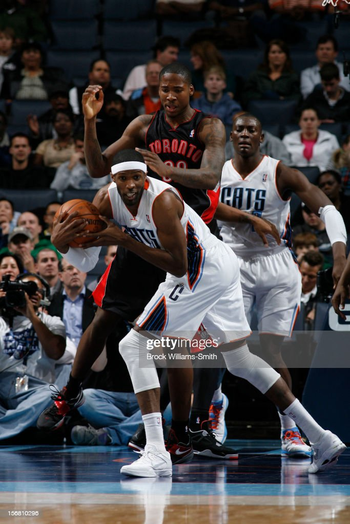 <a gi-track='captionPersonalityLinkClicked' href=/galleries/search?phrase=Hakim+Warrick&family=editorial&specificpeople=210640 ng-click='$event.stopPropagation()'>Hakim Warrick</a> #21 of the Charlotte Bobcats drives against Ed Davis #32 of the Toronto Raptors at the Time Warner Cable Arena on November 21, 2012 in Charlotte, North Carolina.