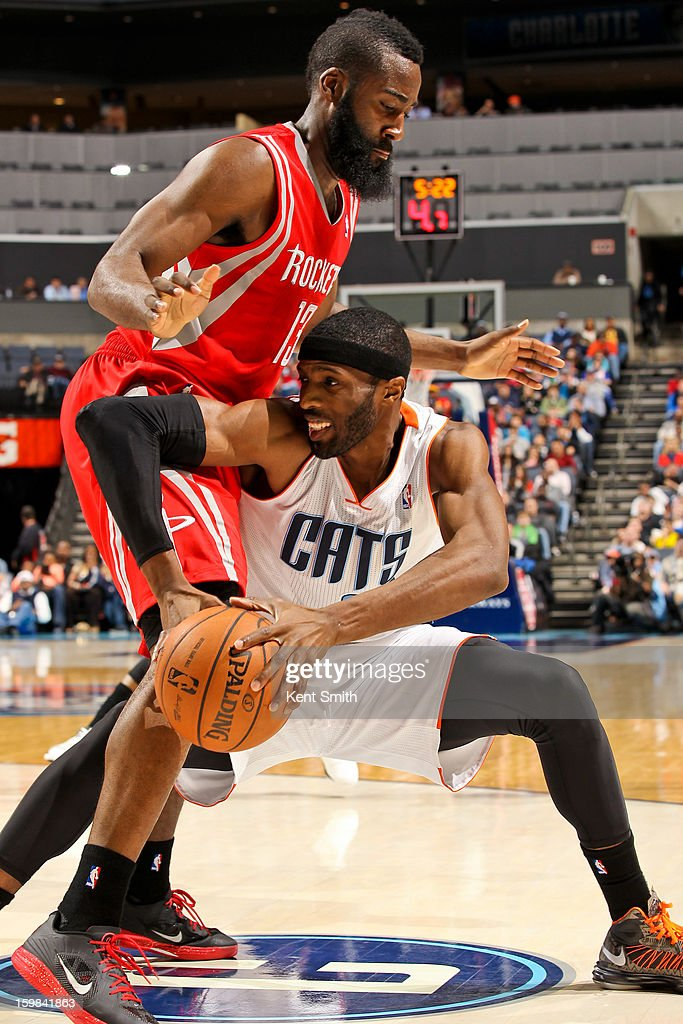 Hakim Warrick #21 of the Charlotte Bobcats drives against James Harden #13 of the Houston Rockets at the Time Warner Cable Arena on January 21, 2013 in Charlotte, North Carolina.