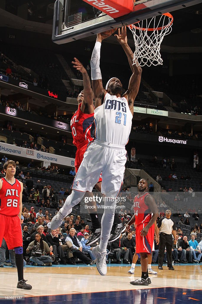 <a gi-track='captionPersonalityLinkClicked' href=/galleries/search?phrase=Hakim+Warrick&family=editorial&specificpeople=210640 ng-click='$event.stopPropagation()'>Hakim Warrick</a> #21 of the Charlotte Bobcats drives to the basket against the Atlanta Hawks at the Time Warner Cable Arena on January 23, 2013 in Charlotte, North Carolina.