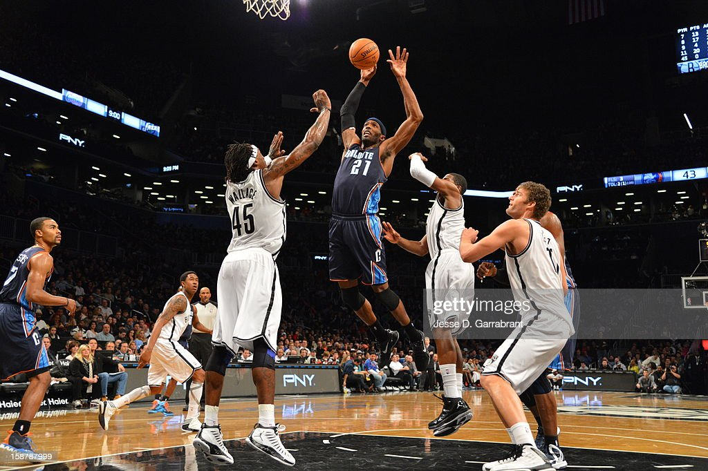 Hakim Warrick #21 of the Charlotte Bobcats dunks the ball against Gerald Wallace #45 of the Brooklyn Nets during the game at the Barclays Center on December 28, 2012 in Brooklyn, New York.