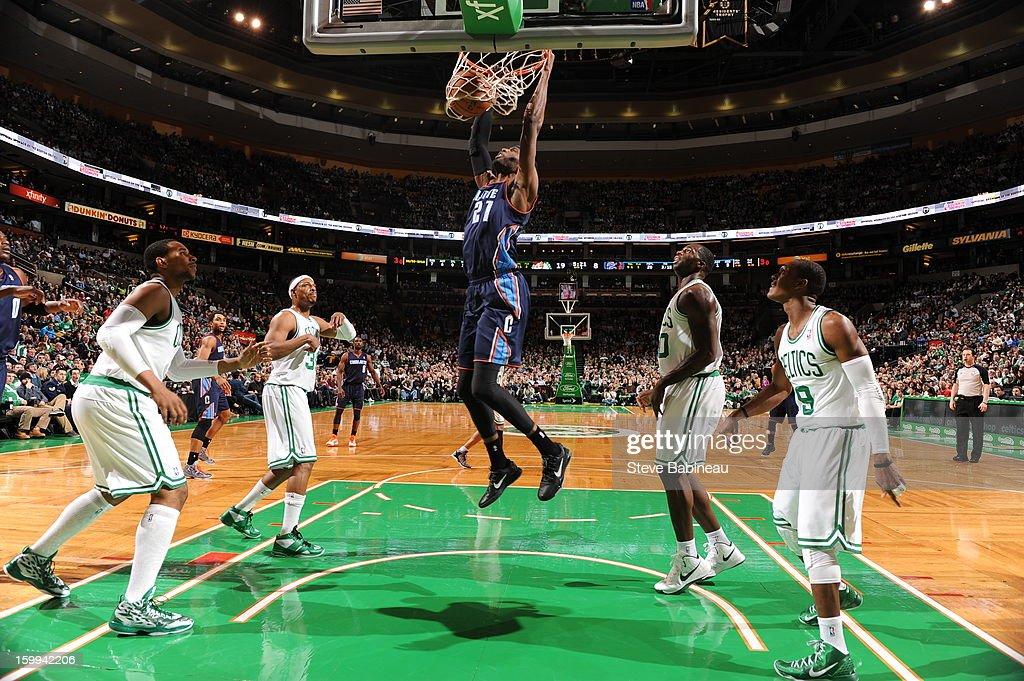 Hakim Warrick of the Charlotte Bobcats dunks the ball against the Boston Celtics on January 14 2013 at the TD Garden in Boston Massachusetts NOTE TO...