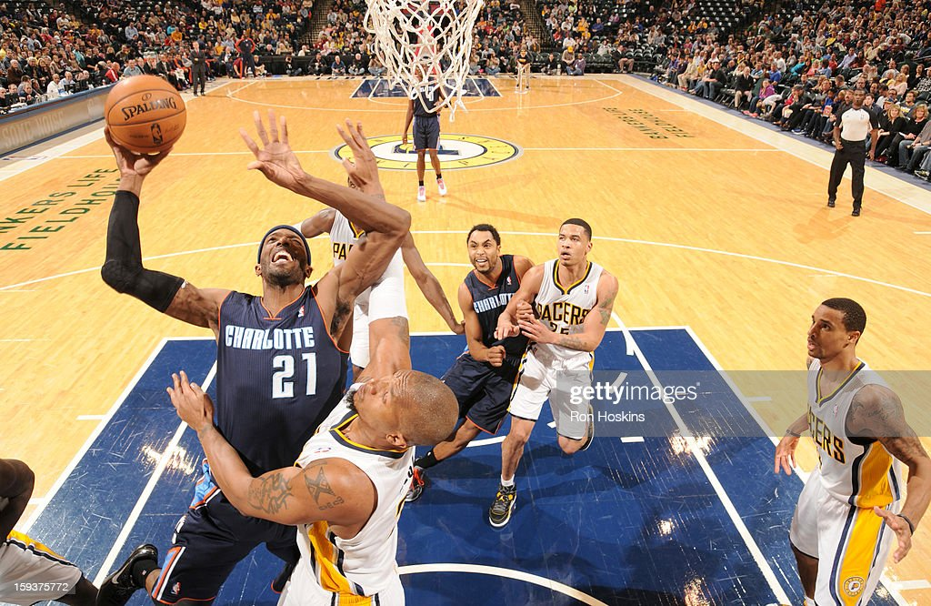 <a gi-track='captionPersonalityLinkClicked' href=/galleries/search?phrase=Hakim+Warrick&family=editorial&specificpeople=210640 ng-click='$event.stopPropagation()'>Hakim Warrick</a> #21 of the Charlotte Bobcats goes to the basket against David West #21 of the Indiana Pacers during the game between the Indiana Pacers and the Charlotte Bobcats on January 12, 2013 at Bankers Life Fieldhouse in Indianapolis, Indiana.