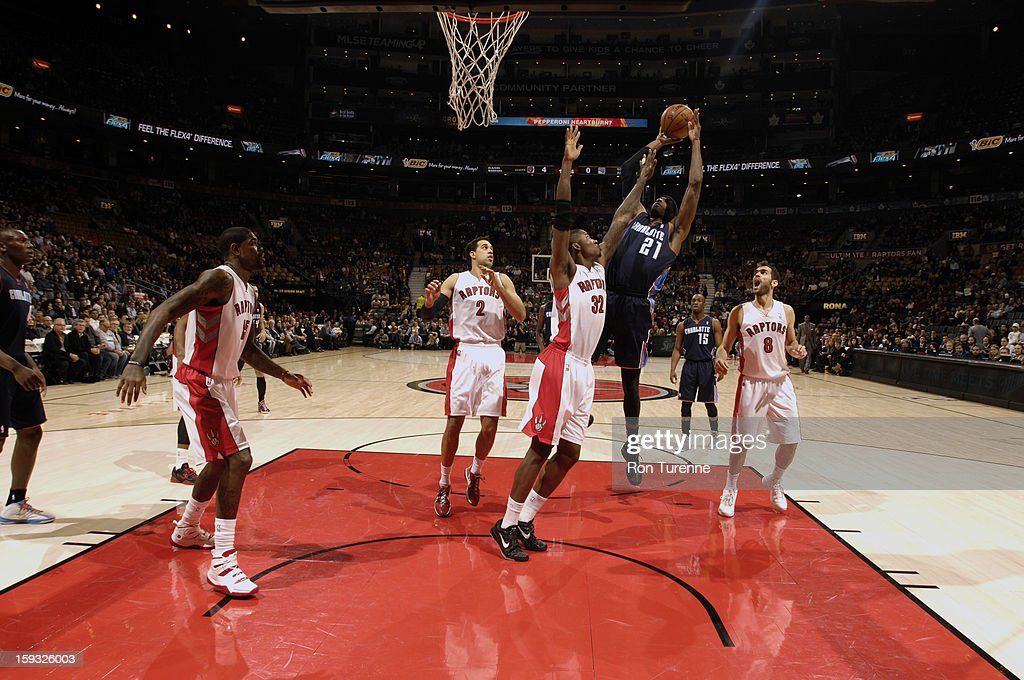 Hakim Warrick #21 of the Charlotte Bobcats goes up for a shot against Ed Davis #32 of the Toronto Raptors during the game on January 11, 2013 at the Air Canada Centre in Toronto, Ontario, Canada.