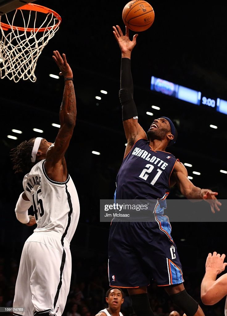 Hakim Warrick #21 of the Charlotte Bobcats in action against Gerald Wallace #45 of the Brooklyn Nets at Barclays Center on December 28, 2012 in the Brooklyn borough of New York City.The Nets defeated the Bobcats 97-81.