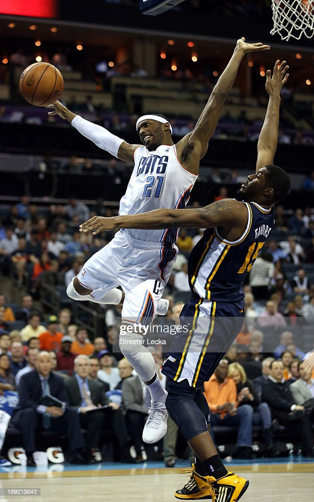 Hakim Warrick of the Charlotte Bobcats is hit by Derrick Favors of the Utah Jazz during their game at Time Warner Cable Arena on January 9 2013 in...