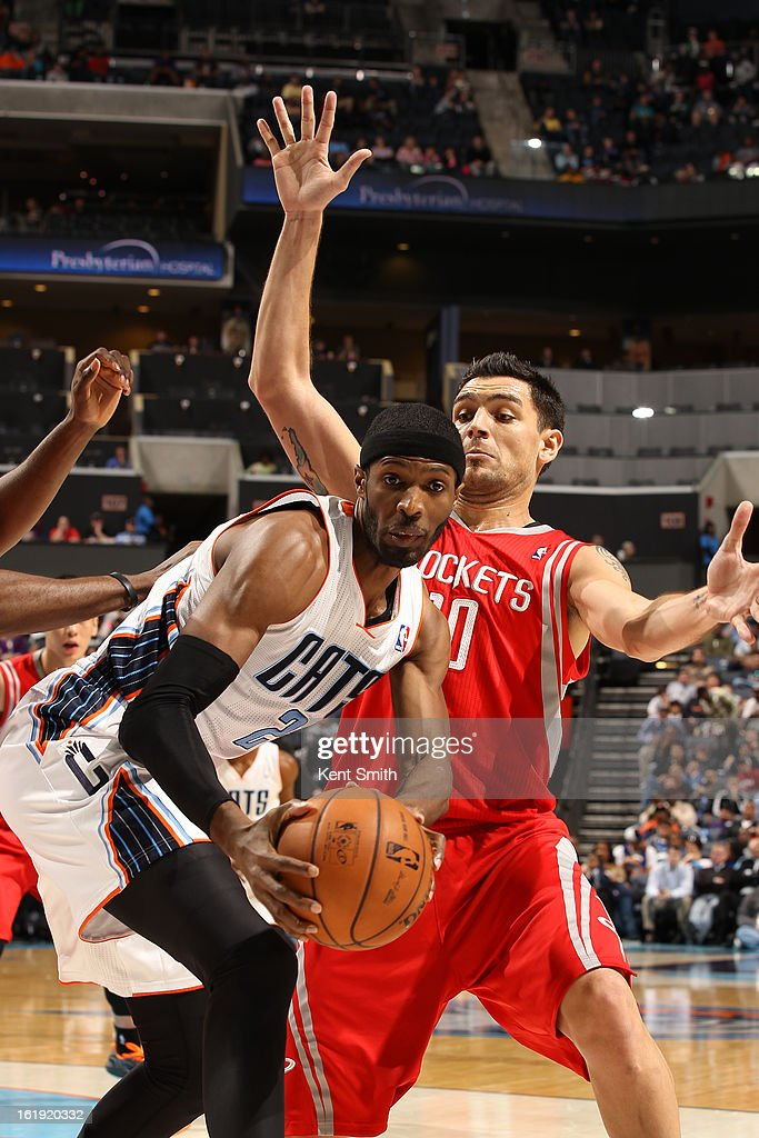 Hakim Warrick #21 of the Charlotte Bobcats looks to pass the ball against Carlos Delfino #10 of the Houston Rockets at the Time Warner Cable Arena on January 21, 2013 in Charlotte, North Carolina.