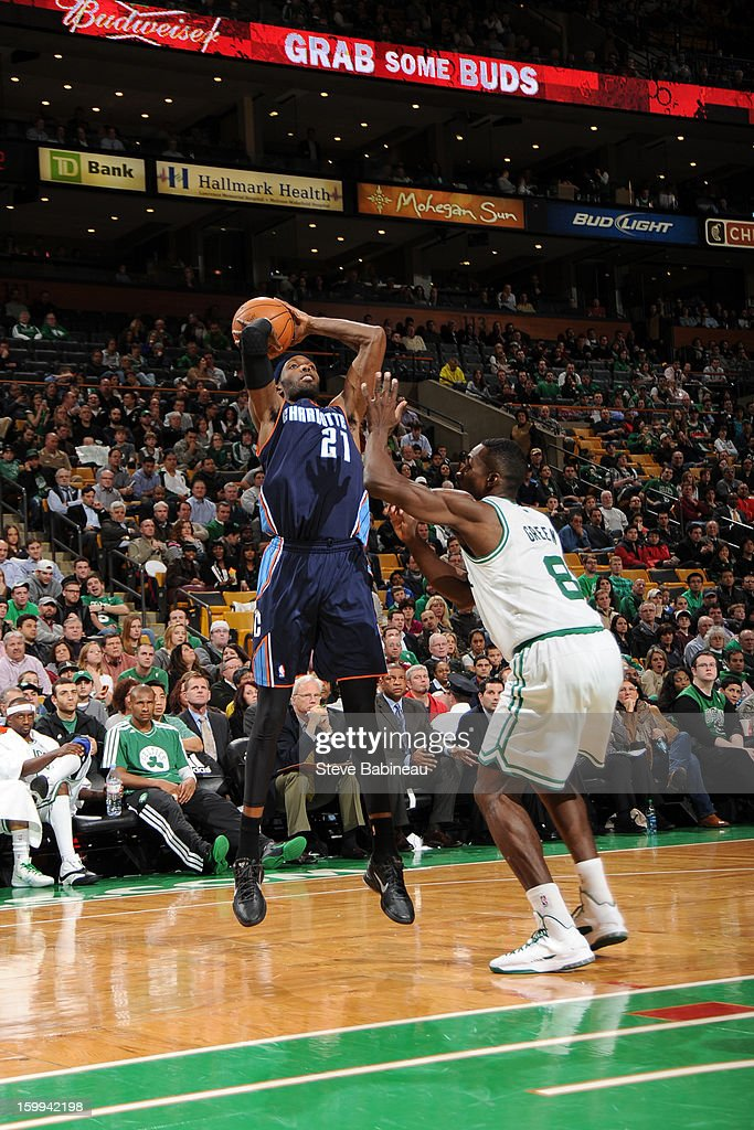 Hakim Warrick #21 of the Charlotte Bobcats shoots against Jeff Green #8 of the Boston Celtics on January 14, 2013 at the TD Garden in Boston, Massachusetts.