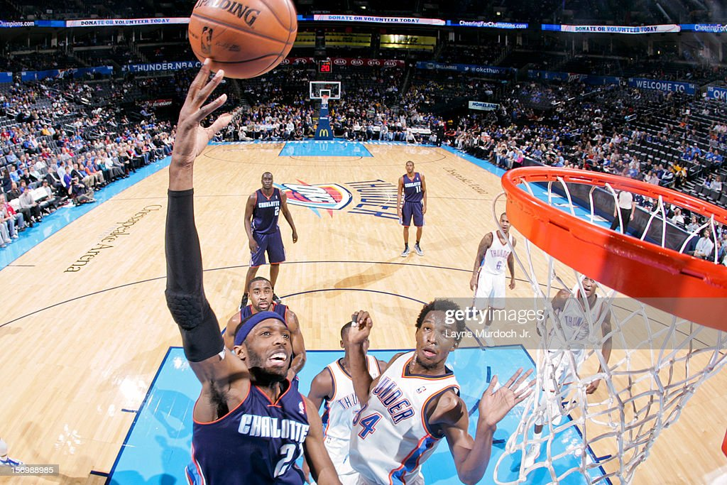 <a gi-track='captionPersonalityLinkClicked' href=/galleries/search?phrase=Hakim+Warrick&family=editorial&specificpeople=210640 ng-click='$event.stopPropagation()'>Hakim Warrick</a> #21 of the Charlotte Bobcats shoots in the lane against <a gi-track='captionPersonalityLinkClicked' href=/galleries/search?phrase=Hasheem+Thabeet&family=editorial&specificpeople=4003778 ng-click='$event.stopPropagation()'>Hasheem Thabeet</a> #34 of the Oklahoma City Thunder on November 26, 2012 at the Chesapeake Energy Arena in Oklahoma City, Oklahoma.