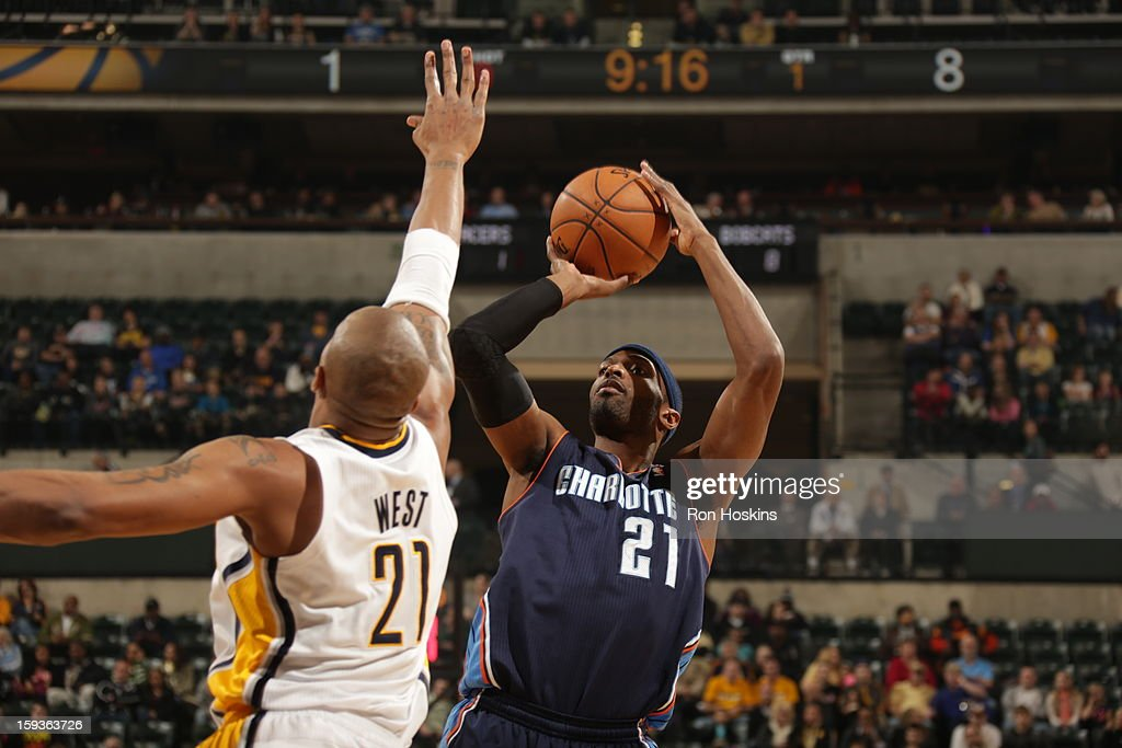 Hakim Warrick #21 of the Charlotte Bobcats shoots the ball over David West #21 of the Indiana Pacers shoots the ball against during the game between the Indiana Pacers and the Charlotte Bobcats on January 12, 2013 at Bankers Life Fieldhouse in Indianapolis, Indiana.