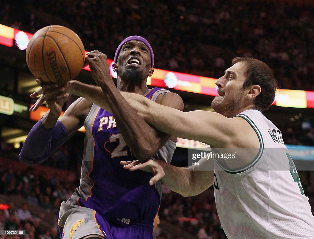 Hakim Warrick of the Phoenix Suns is fouled by Nenad Krstic of the Boston Celtics on March 2 2011 at the TD Garden in Boston Massachusetts The...