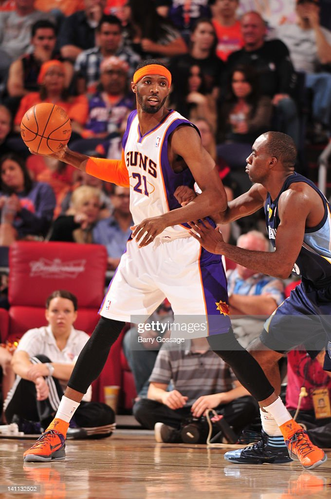 Hakim Warrick of the Phoenix Suns is guarded by Quincy Pondexter of the Memphis Grizzlies in an NBA game played on March 10 2012 at US Airways Center...
