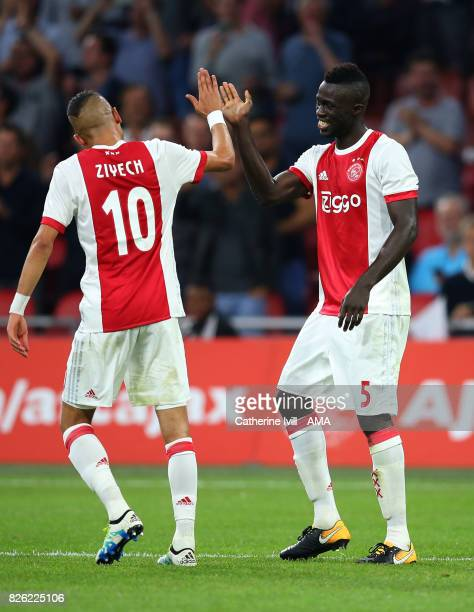 Hakim Ziyech and Davinson Sanchez of Ajax during the UEFA Champions League Qualifying Third Round match between Ajax and OSC Nice at Amsterdam Arena...
