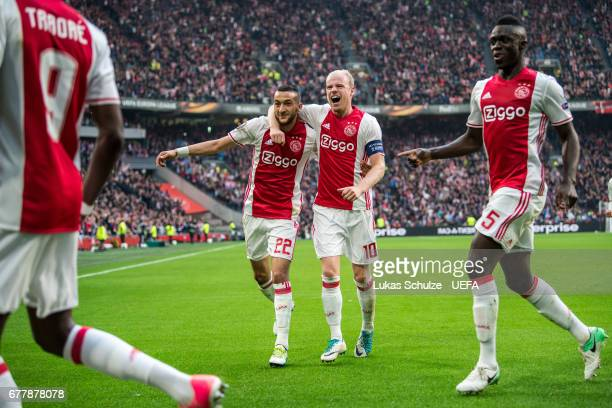 Hakim Ziyech and Davy Klaassen of Amsterdam celebrate their teams first goal during the Uefa Europa League semi final first leg match between Ajax...