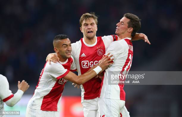 Hakim Ziyech Joel Veltman and Nick Viergever of Ajax during the UEFA Champions League Qualifying Third Round match between Ajax and OSC Nice at...