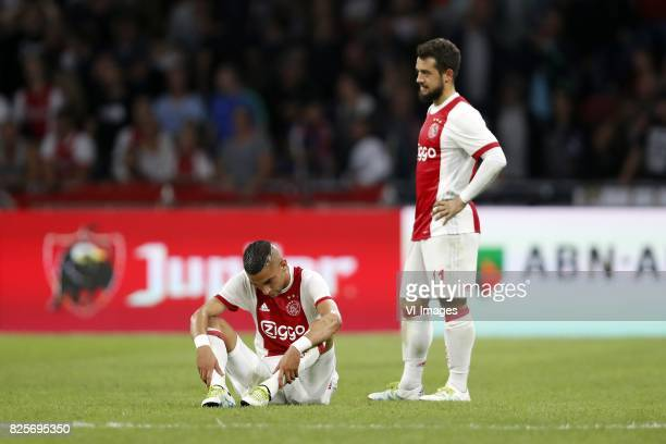 Hakim Ziyech of Ajax Amin Younes of Ajax during the UEFA Champions League third round qualifying first leg match between Ajax Amsterdam and OGC Nice...