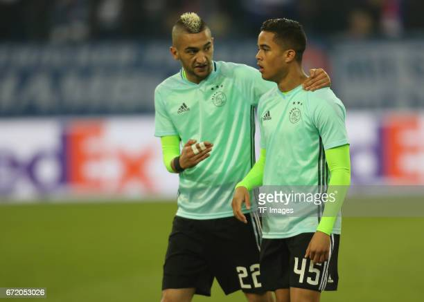 Hakim Ziyech of Ajax Amsterdam speak with Justin Kluivert during the UEFA Europa League quarter final second leg match between FC Schalke 04 and Ajax...