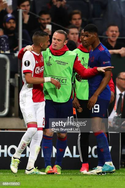 Hakim Ziyech of Ajax clashes with Marcus Rashford of Manchester United as Wayne Rooney tries to intervene during the UEFA Europa League Final match...